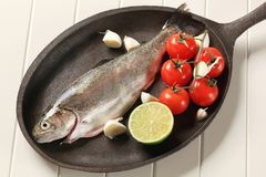 Fresh trout on a cast iron skillet Stock Photos