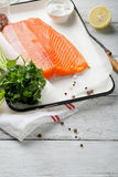 Fresh trout fillet with spice on white boards Stock Photo