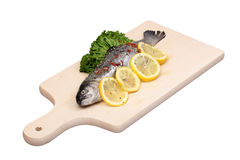 Fresh trout fish. Fresh fish on cutting board isolated with clipping path Stock Photography