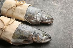 Free Fresh Trout Fish Wrapped In Paper Stock Image - 110751411