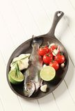 Fresh trout on a skillet Stock Images