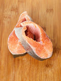 Fresh trout steaks on cutting board. Two fresh trout steaks on cutting board Stock Photos