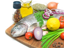 Fresh trout, vegetables, lemon and spices close up Stock Photo
