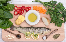 Fresh trout with vegetables Royalty Free Stock Images