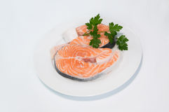 Fresh trout on the white plate, served with Stock Photos