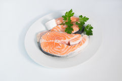 Fresh trout on the white plate, served with parsley Stock Photography