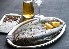Fresh trouts in ice on the vintage metal tray Stock Photo