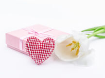 Fresh tulip flower and red checkered textile, fabric heart and gift Royalty Free Stock Images