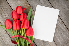 Fresh tulips bouquet and blank card for copy space Stock Photos