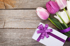 Fresh tulips bouquet and gift box Royalty Free Stock Image