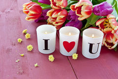 Fresh tulips and candles Royalty Free Stock Photography
