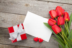 Fresh tulips, gift box and greeting card Stock Photo