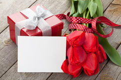 Fresh tulips, gift box and greeting card Stock Photo