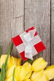 Fresh tulips and gift box Stock Photo