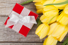 Fresh tulips and gift box Royalty Free Stock Photography
