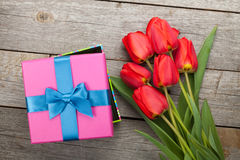 Fresh tulips and gift box Stock Images