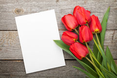 Fresh tulips and greeting card Royalty Free Stock Images
