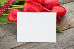 Fresh tulips and greeting card Royalty Free Stock Photo