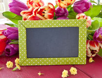 Fresh tulips and a little chalkboard Royalty Free Stock Photos