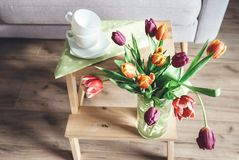 Fresh tulips in vase cozy home spring decoration stock images