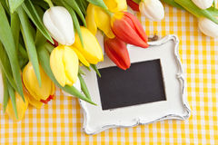 Fresh tulips and a vintage chalkboard. Fresh colorful tulips and a vintage chalkboard Stock Images