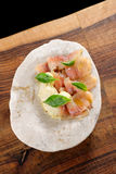 Fresh Tuna carpaccio with basil. Radish, onion and olive oil Stock Images