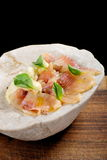 Fresh Tuna carpaccio with basil. Radish, onion and olive oil Stock Photos