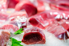 Fresh tuna fish on market display. Fresh tuna fish on cooled market display royalty free stock image