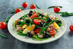 Fresh Tuna Green Bean salad with eggs, tomatoes, beans, olives on white plate. concept healthy food Stock Photography