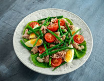 Fresh Tuna Green Bean salad with eggs, tomatoes, beans on white plate. concept healthy food Stock Image