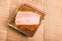 Fresh tuna steak marinating in bowl Stock Images