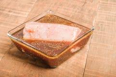 Fresh tuna steak marinating in bowl Royalty Free Stock Image