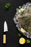 Fresh turbot fish on ice on a black stone table Stock Photo