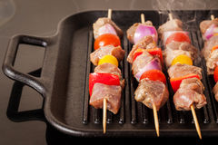 Fresh turkey meat skewers with cherry tomatoes, pepper and onion Royalty Free Stock Images