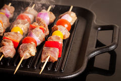 Fresh turkey meat skewers with cherry tomatoes, pepper and onion Stock Photo