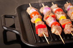 Fresh turkey meat skewers with cherry tomatoes, pepper and onion Royalty Free Stock Image