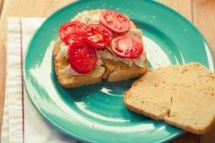 Fresh turkey sandwich on a blue plate Royalty Free Stock Photography