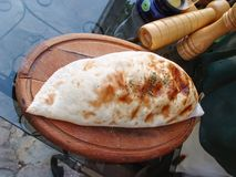 Turkish bread on an old wooden tray. Fresh Turkish bread on an old wooden tray Stock Photography