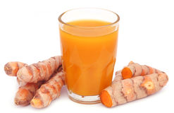 Fresh turmeric with extract in a glass Stock Photos