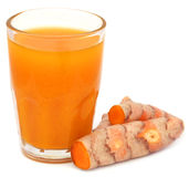 Fresh turmeric with extract in a glass Royalty Free Stock Photo