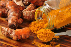 Fresh turmeric. Root, and ground spice - shallow depth of field Stock Photography
