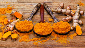 Fresh turmeric roots. On wooden table Royalty Free Stock Images