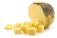 Fresh turnip pieces(brassica rape rapa). Fresh turnip(brassica rape rapa) and some cut blocks on a white background Stock Photo