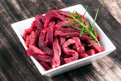 Fresh uncocked Beef sliced meat, rosemary Stock Images