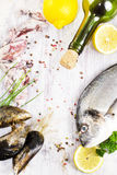 Fresh uncooked dorado fish and mussels on light wooden backgroun Stock Photography
