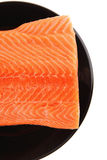 Fresh uncooked red fish fillet on black Stock Photos