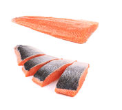 Fresh uncooked red fish fillet and slices. Isolated on a white background Royalty Free Stock Images