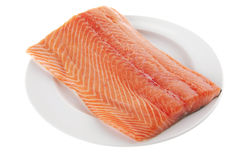 Fresh uncooked salmon fillet on. Fresh raw red fish fillet on white plate Stock Images