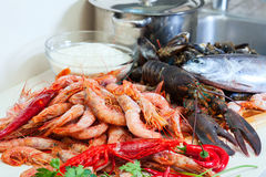Fresh uncooked sea food specialties and rice. In domestic kitchen Royalty Free Stock Photos
