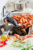 Fresh uncooked seafood and  spices Stock Photos
